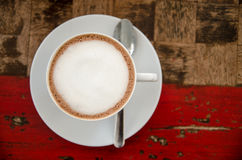 Coffee cup on the wood texture background Royalty Free Stock Images