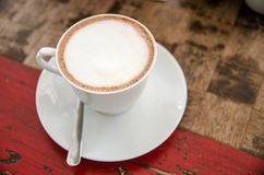 Coffee cup on the wood texture background Royalty Free Stock Image