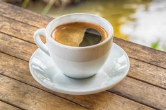 Coffee cup on woodden table Royalty Free Stock Images