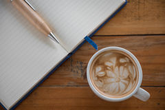 Coffee cup on woodden table Stock Photo