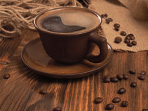Coffee cup on a wooden backgound. Stock Photos