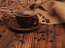 Coffee cup on a wooden backgound. Royalty Free Stock Photos