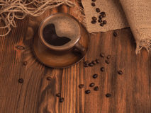 Coffee cup on a wooden backgound. Stock Images