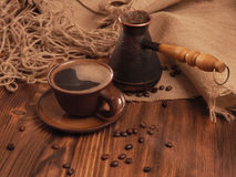 Coffee cup on a wooden backgound. Stock Image
