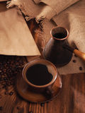 Coffee cup on a wooden backgound. Royalty Free Stock Images