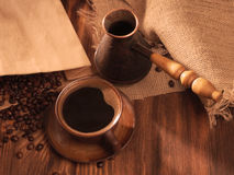 Coffee cup on a wooden backgound. Royalty Free Stock Image