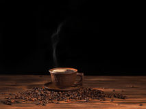 Coffee cup on a wooden backgound. Stock Photo