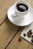 Coffee cup on wooden background Stock Images