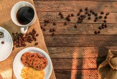 Coffee cup on wooden Stock Images