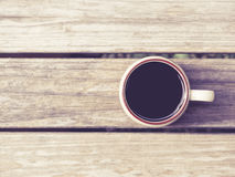 Coffee cup on Wooden background Vintage style Stock Images