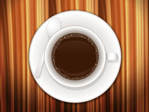 Coffee cup on wooden desk Stock Photos