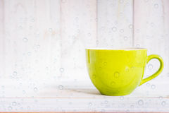 Coffee cup on a wooden floor Royalty Free Stock Photo