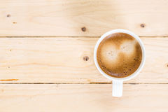 Coffee cup on wooden floor Royalty Free Stock Images