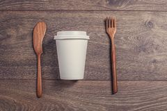 Coffee cup and wooden fork and knife. Stock Photo