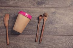 Coffee cup and wooden fork and knife. Royalty Free Stock Image