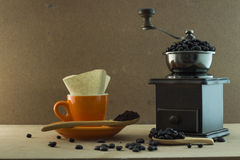 Coffee cup with wooden manul grinder Stock Image