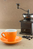 Coffee cup with wooden manul grinder Royalty Free Stock Photo