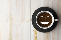 Coffee cup on wooden and smile face conception Royalty Free Stock Images