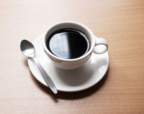 Coffee Cup on Wooden Table Royalty Free Stock Images