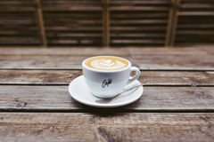 Coffee cup on wooden table Stock Images