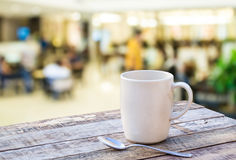 Coffee cup on wooden table with blurr background Stock Photos