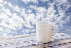 Coffee cup on wooden table with blurr background Stock Photography