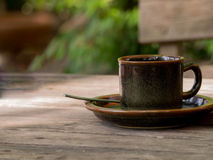 Coffee cup on wooden table close-up Royalty Free Stock Images