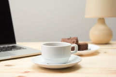 Coffee cup on wooden table. Closeup coffee cup on wooden table Royalty Free Stock Images