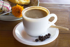 Coffee cup on a wooden table Royalty Free Stock Photo