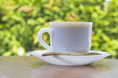 Coffee cup on a wooden table Royalty Free Stock Image