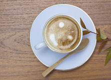 Coffee cup on a wooden table Stock Images