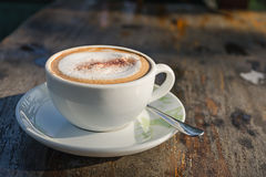 Coffee cup on wooden table Royalty Free Stock Photo