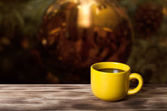 Coffee in cup on wooden table opposite a blurred background Stock Photo