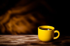 Coffee in cup on wooden table opposite a blurred background. Ton Stock Photography