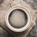 Coffee cup on wooden table texture. Royalty Free Stock Photography