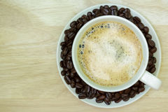 Coffee cup on wooden table. View from the top Stock Images
