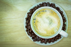 Coffee cup on wooden table. View from the top Royalty Free Stock Photos
