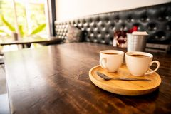 Coffee cup in wooden tray vintage style. Coffee cup in wooden tray in vintage style cafe stock image