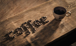 Coffee cup and word coffee made from coffee-beans Stock Image