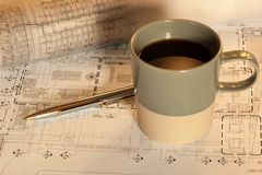 Coffee cup with work plan stock photos