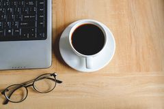 Coffee cup on work table royalty free stock photos