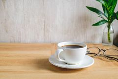 Coffee cup on work table stock illustration