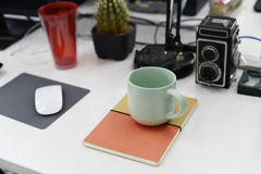 Coffee Cup on Work Table Nobody Royalty Free Stock Photography