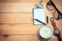 Coffee cup on workspace table Stock Photo