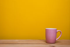 Coffee cup on yellow background. Coffee cup on a yellow background Stock Photos
