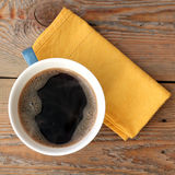 Coffee in a cup with yellow napkin Royalty Free Stock Image