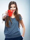 Coffee cup. Young woman on isolated studio background drink co Royalty Free Stock Image