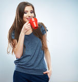 Coffee cup. Young woman on isolated studio background drink co Stock Photo