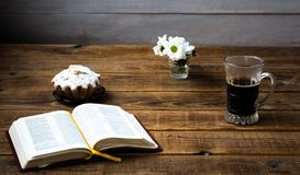 A coffee cupcake flowers and a book on a wooden background. Coffee cupcake flowers and a book on a wooden background royalty free stock images