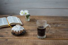 A coffee cupcake flowers and open book on a wooden background. Coffee cupcake flowers and open book on a wooden background royalty free stock photo